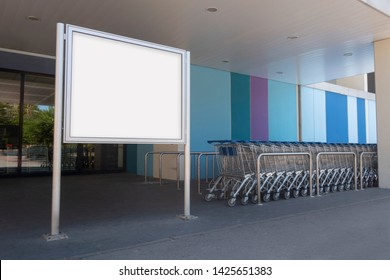 Blank billboard mock up in a supermarket, in front of shopping carts