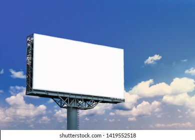 Blank billboard mockup with white screen against clouds and blue sky background. Copy space banner for advertisement. Business Concept.