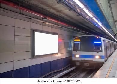 blank billboard in MRT station with train