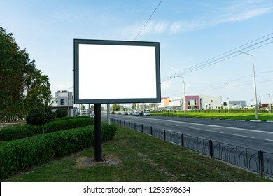 Blank Billboard next to the highway , the background for your advertising. Mock up