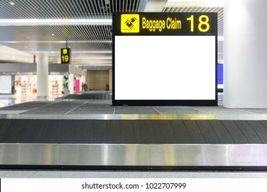 Blank billboard on Baggage claim area in the airport,Empty Baggage conveyor belt at the airport