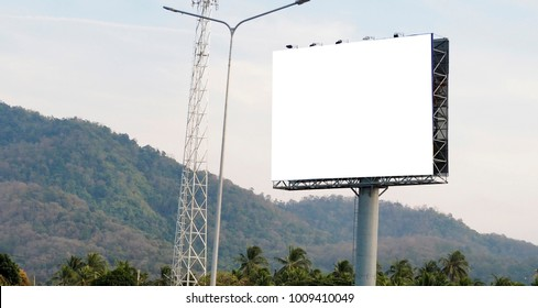 Blank billboard on blue sky background for new advertisement.
