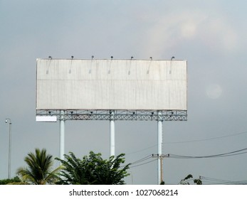 Blank billboard on blue sky  background for new advertisements