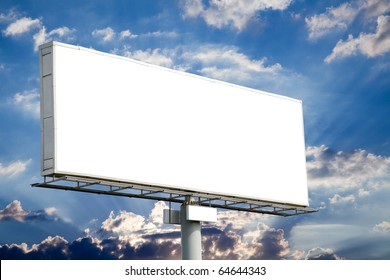 Blank billboard on blue sky with sun rays for your advertisement