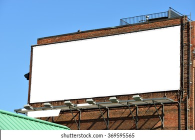 Blank billboard on brick wall, banner edge and grommets preserved for a more realistic look