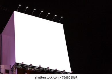 blank billboard on the building urban in the night - can advertisement for display or montage product or business