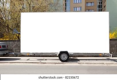 Blank billboard on car trailer
