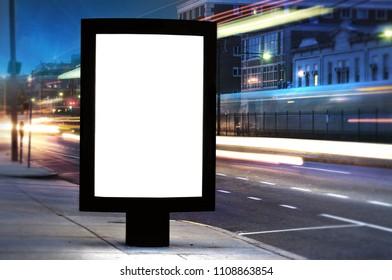 Blank Billboard on City Street at Night, traffic ligths, blurred train, urban scene