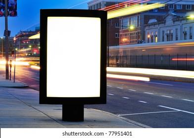Blank Billboard on City Street at Night. Outdoor advertising