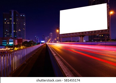 blank billboard on light trails, street and urban in the night - can advertisement for display or montage product or business