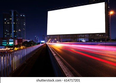 Blank billboard on light trails, street, city and urban in the night - can advertisement for display or montage product or business.