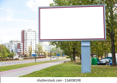 Blank billboard on road in city useful for advertising