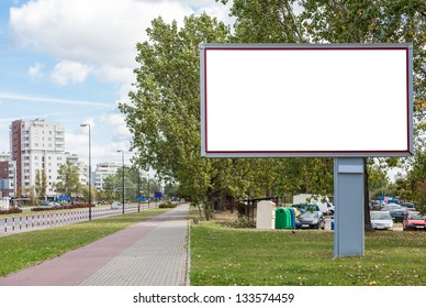 Blank billboard on road in city