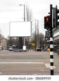 Blank billboard on a roadside in european city