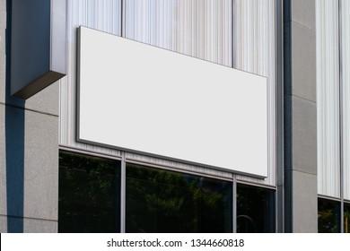 blank billboard on shop entrance, empty sign on store front mockup -