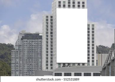 Blank billboard on side of building.