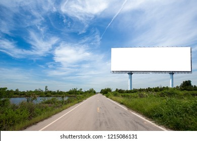 blank billboard on the sideway in the park. image for copy space, advertisement, text and object. white billboard in natural green. Blank billboard ready for new advertisement.