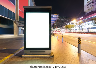 blank billboard on street in midtown of singapore at night