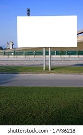 Blank billboard on the street at sunset