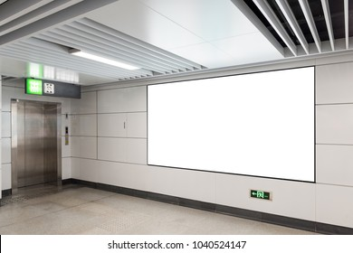Blank billboard on subway station channel wall