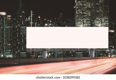 Blank billboard outdoors, Outdoor advertising poster at night time with street light line for advertisement street city night. With clipping path on screen