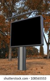 Blank billboard in the park