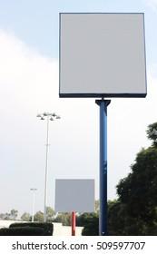 Blank billboard in a parking lot for advertisement.