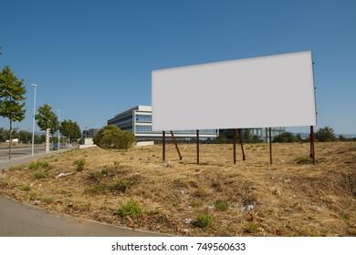 Blank billboard in a plot for sale, development