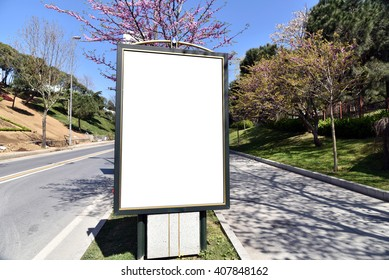 Blank billboard or poster in city center