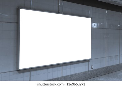 Blank billboard posters in the subway station for advertising.