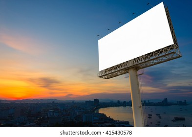 Blank billboard ready for advertisement in city downtown with sunrise background.