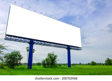 Blank billboard ready for new advertisement on meadow