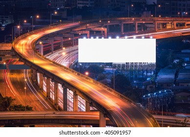 Blank billboard ready for new advertisement at Expressway in modern city downtown, urban view at night time