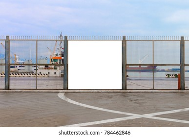 A blank billboard ready for new advertising on the harbor fence