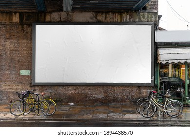 Blank billboard sign mockup in the urban environment, on the facade, empty space to display your advertising or branding campaign - Shutterstock ID 1894438570