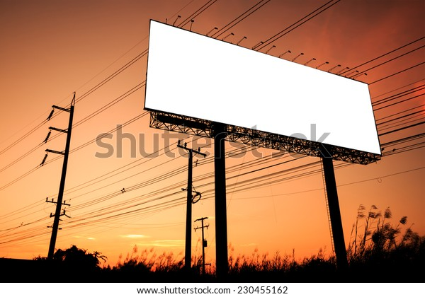 Blank billboard silhouette at sunset for advertisement