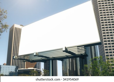 Blank billboard at skyscrapers background, mock up