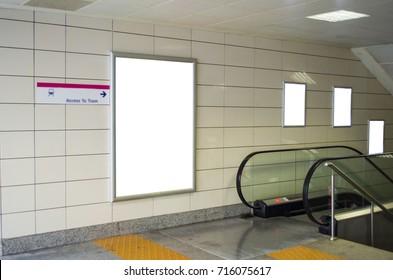 Blank billboard in subway station