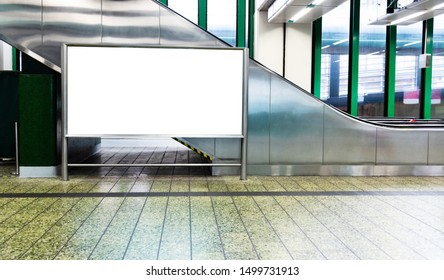 Blank billboard in subway station of city.