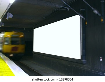 blank billboard in train station