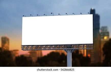 Blank billboard at twilight in the city