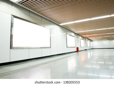 Blank billboard at an  underground passage.