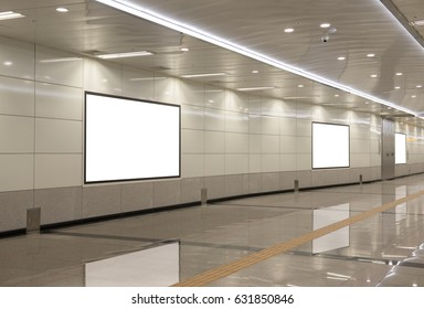 Blank billboard in underground passage with reflection on floor, useful for advertisement, perspective