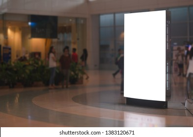 blank billboard white screen LED vertical advertising banner board indoor in subway station ad interior public hall.