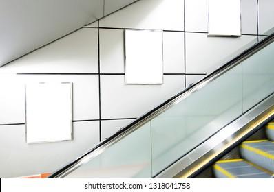 Blank billboards at escalator side.