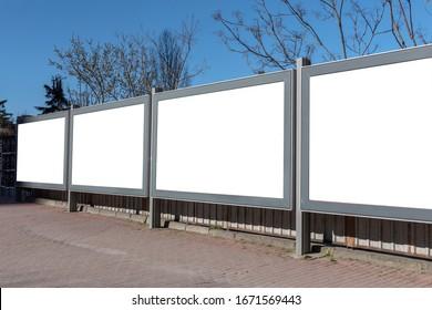 Blank billboards on the blue sky.