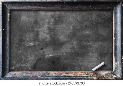 Blank black chalkboard with dark wood frame of slate board and white chalk texture background