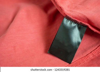 blank black color clothing label on red t shirt