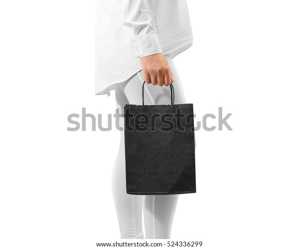 e1d3cc86 Blank black craft textured paper bag mockup holding hand. Woman hold dark  package mock up