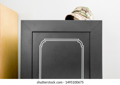 Blank black gun cabinet/safe with military hat on top, gun safety sticker decal mockup